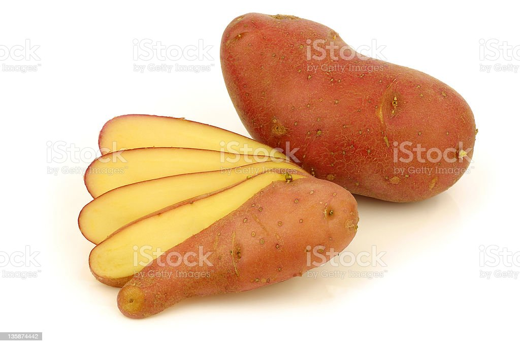 fresh roseval potatoe and a cut one stock photo