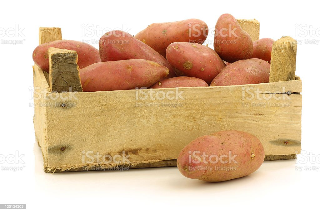 fresh roseval potatoes in a wooden box royalty-free stock photo