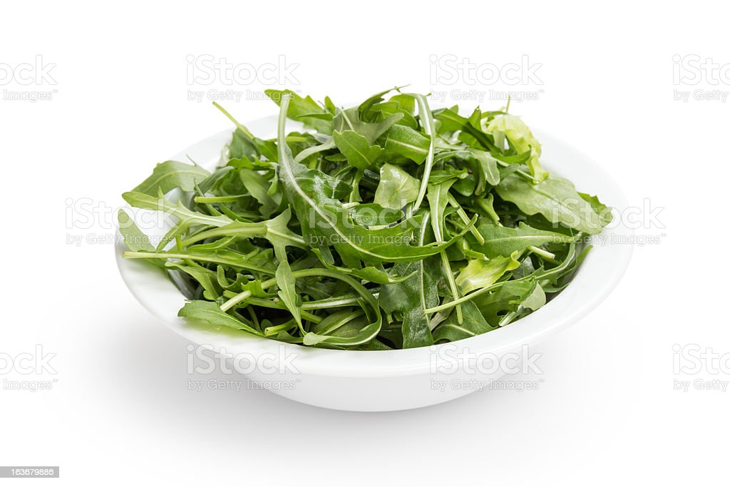 fresh rucola leaves in a bowl royalty-free stock photo