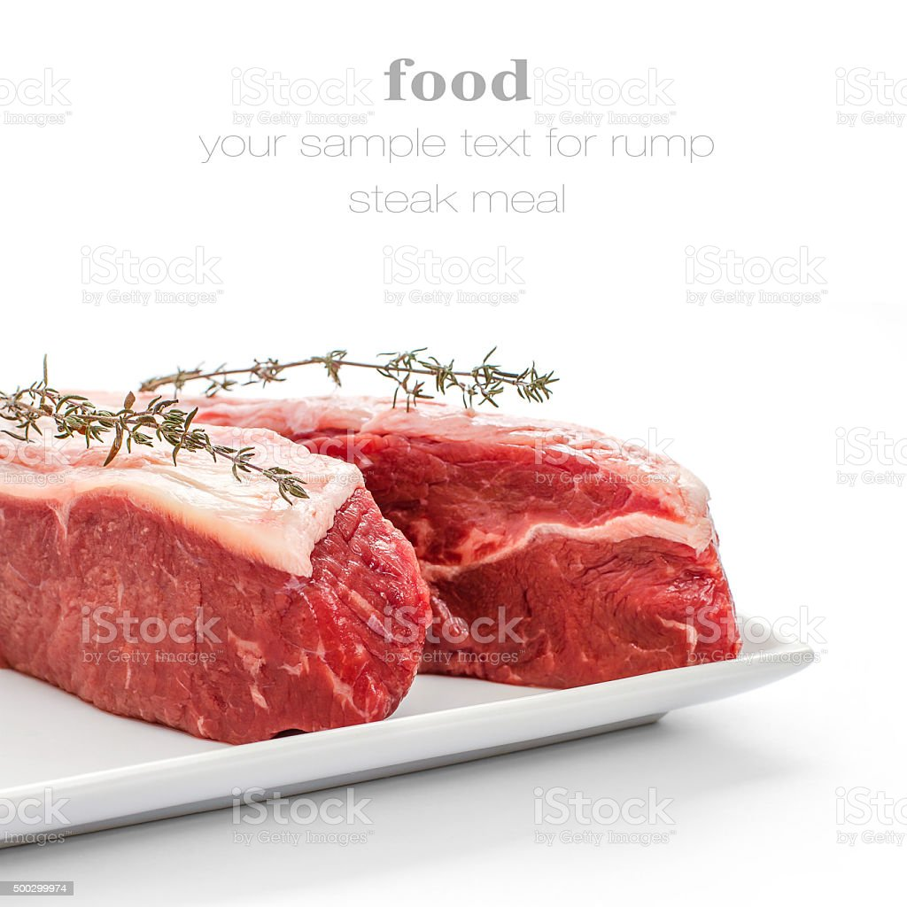 Fresh rump steaks with thymine twig isolated stock photo
