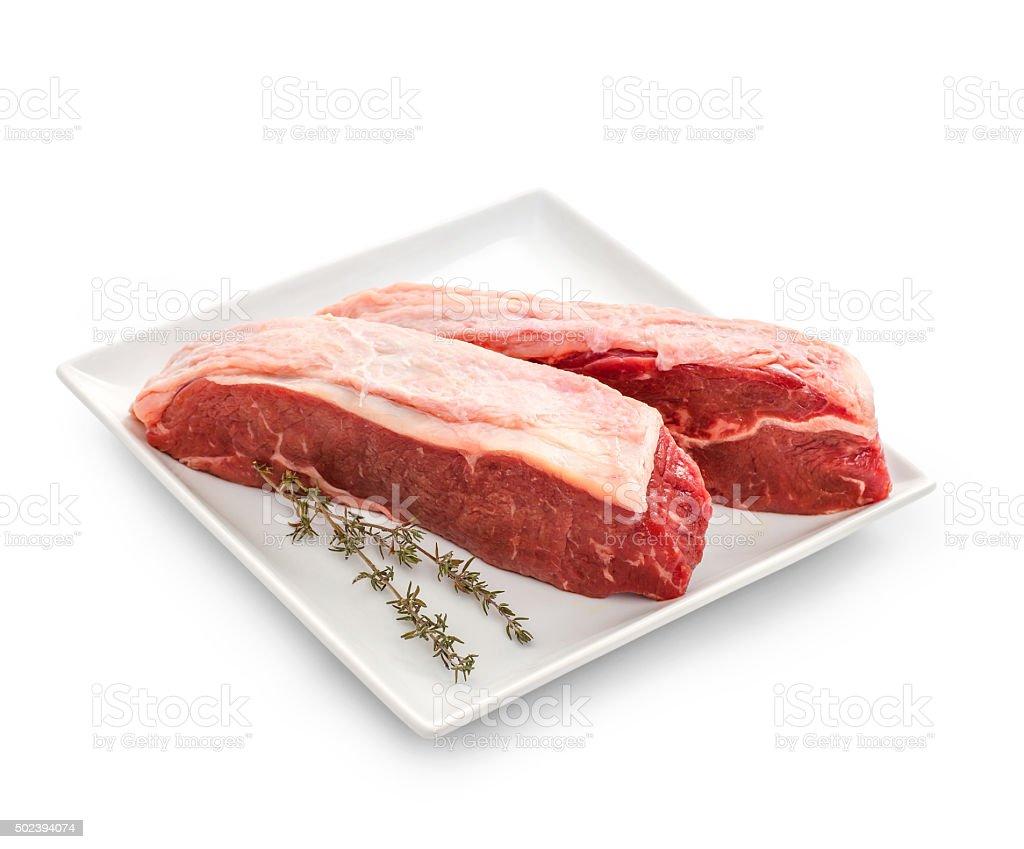 Fresh rump steaks with thymine twig stock photo