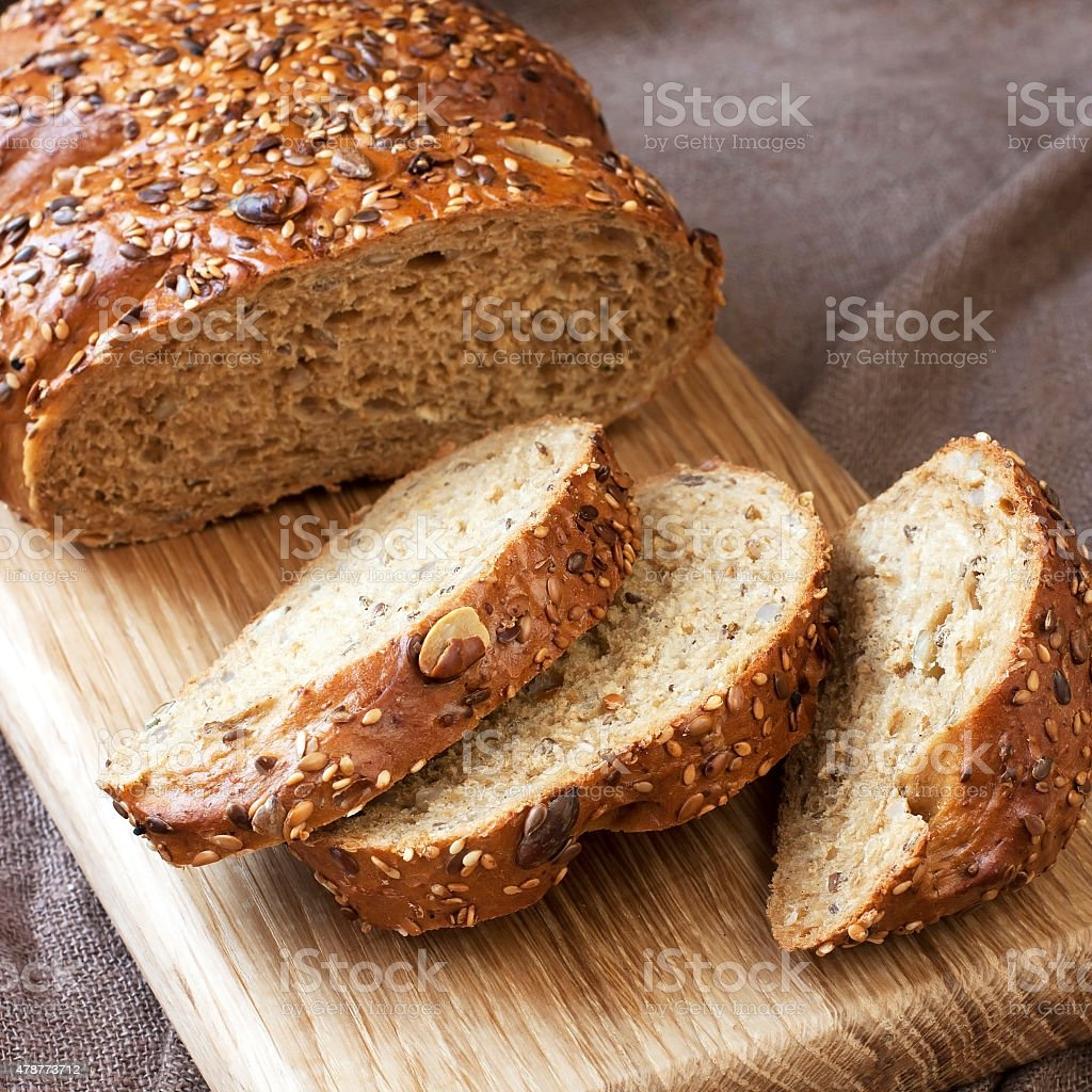 Fresh rye loaf of bread , rustic style stock photo