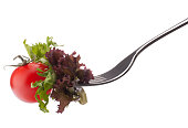 Fresh salad and cherry tomato on fork