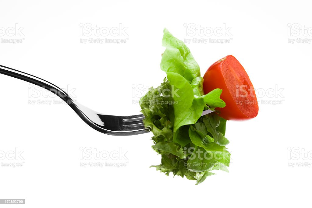 Fresh Salad and Tomato on a metal Fork royalty-free stock photo