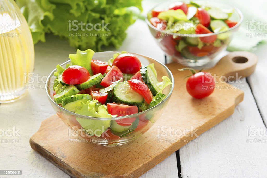 Fresh salad from cucumbers and tomatoes royalty-free stock photo