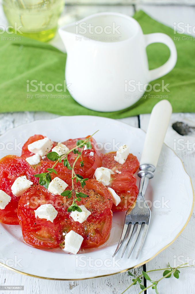 Fresh salad from the black tomatoes and cheese royalty-free stock photo