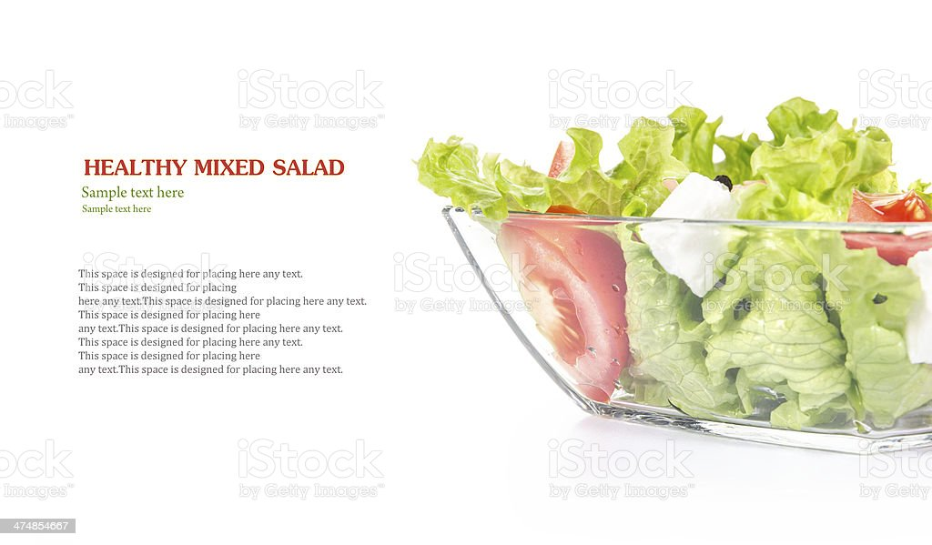 Fresh salad in glass bowl with space for your text stock photo