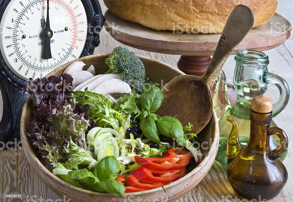 Fresh Salad In Traditional Wooden Bowl royalty-free stock photo