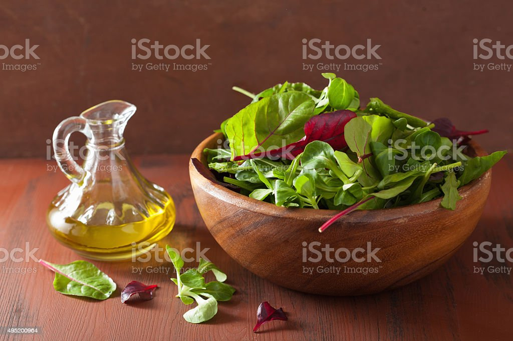 fresh salad leaves in bowl spinach mangold ruccola stock photo