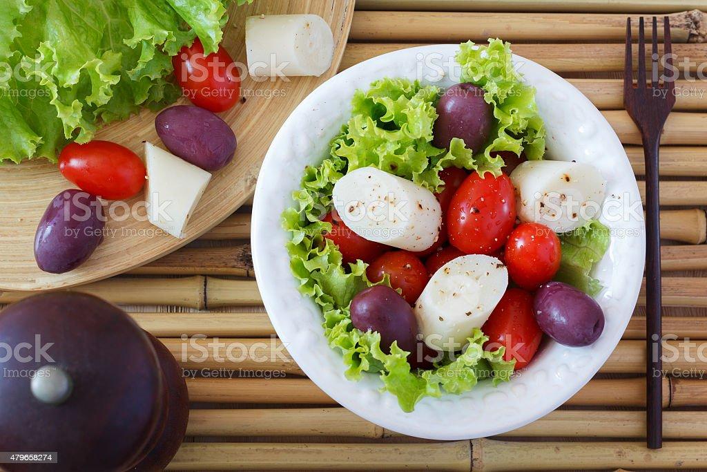Fresh salad of heart of palm (palmito), cherry tomato stock photo