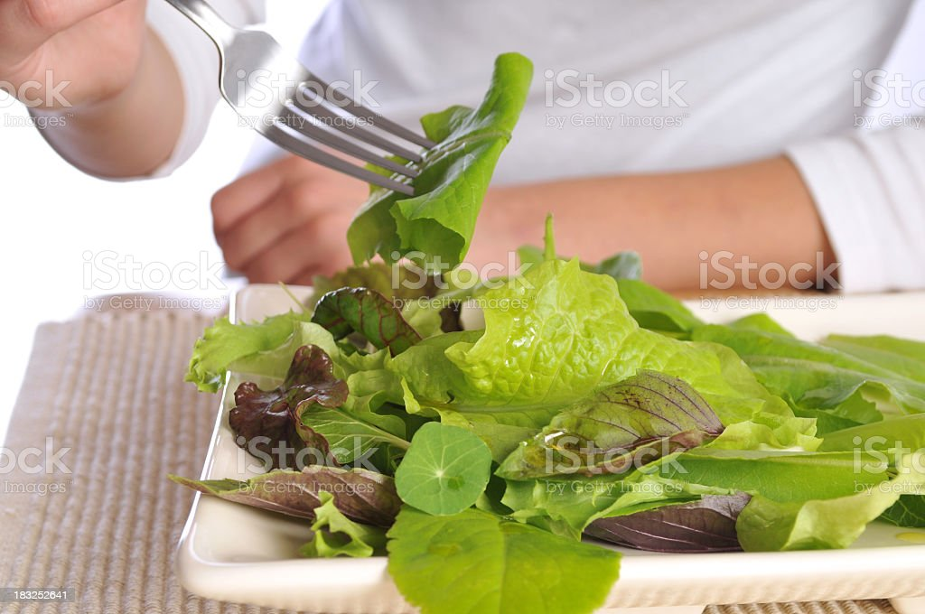 Fresh Salad Presented on a Restaurant Table royalty-free stock photo