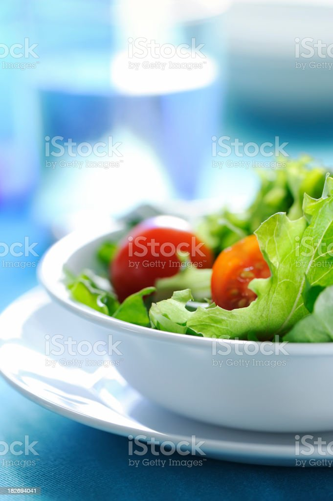 Fresh salad with a white bowl and plate royalty-free stock photo