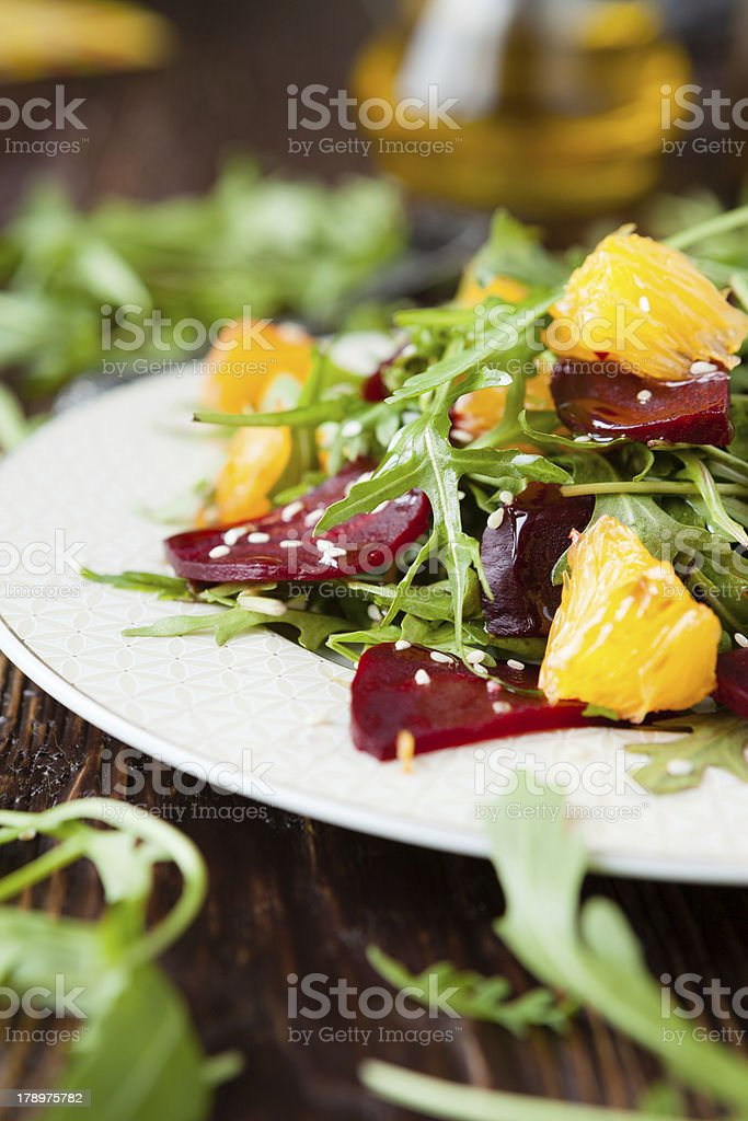 fresh salad with arugula and citrus, healthy food stock photo
