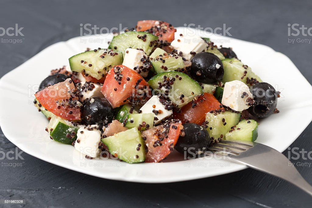 Fresh salad with black quinoa, tomatoes, cucumbers and feta chee stock photo