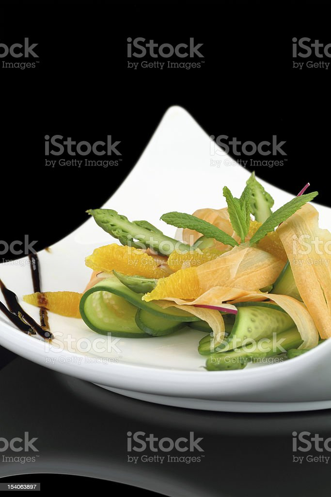 Fresh salad with carrot and cucumber royalty-free stock photo