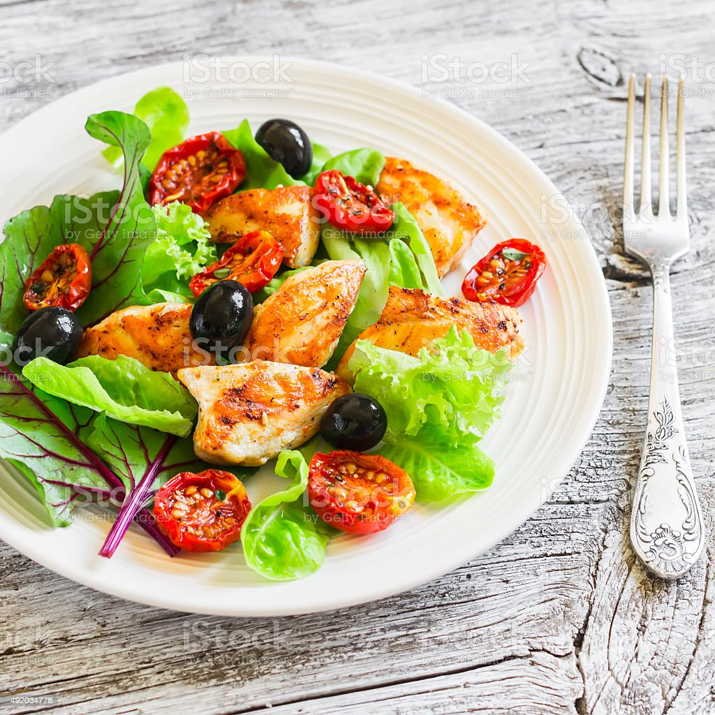 Fresh salad with chicken breast   and sun-dried tomatoes stock photo