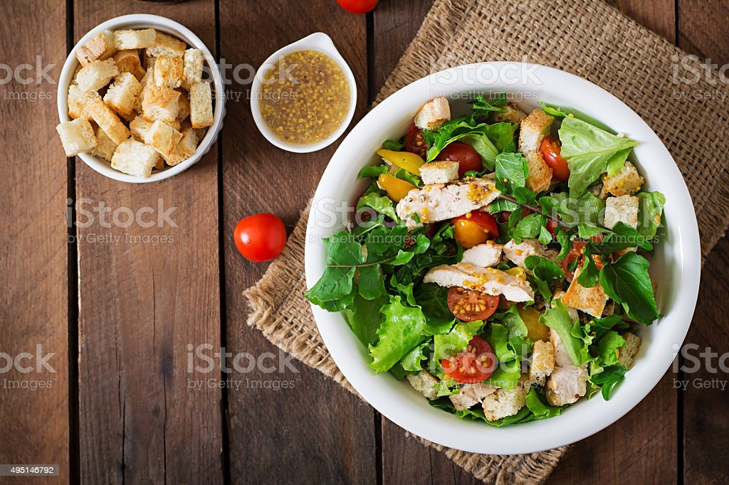 Fresh salad with chicken breast, arugula, lettuce and tomato. stock photo