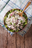 Fresh salad with chicken, onion, celery and cucumber. vertical