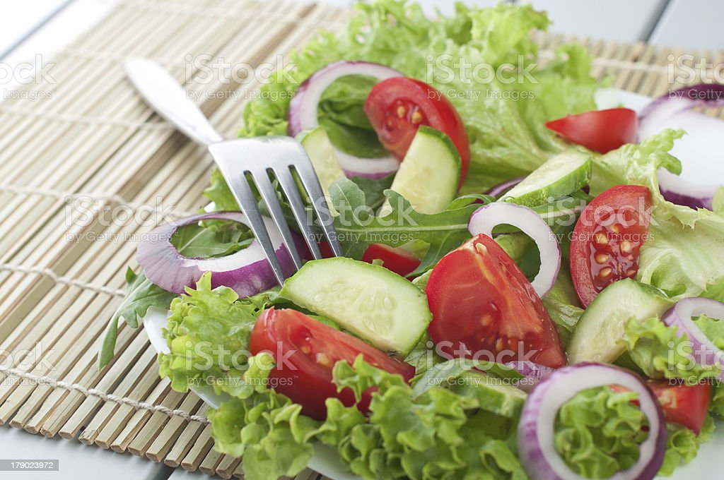 Fresh salad with cucumbers tomatoes and onions stock photo