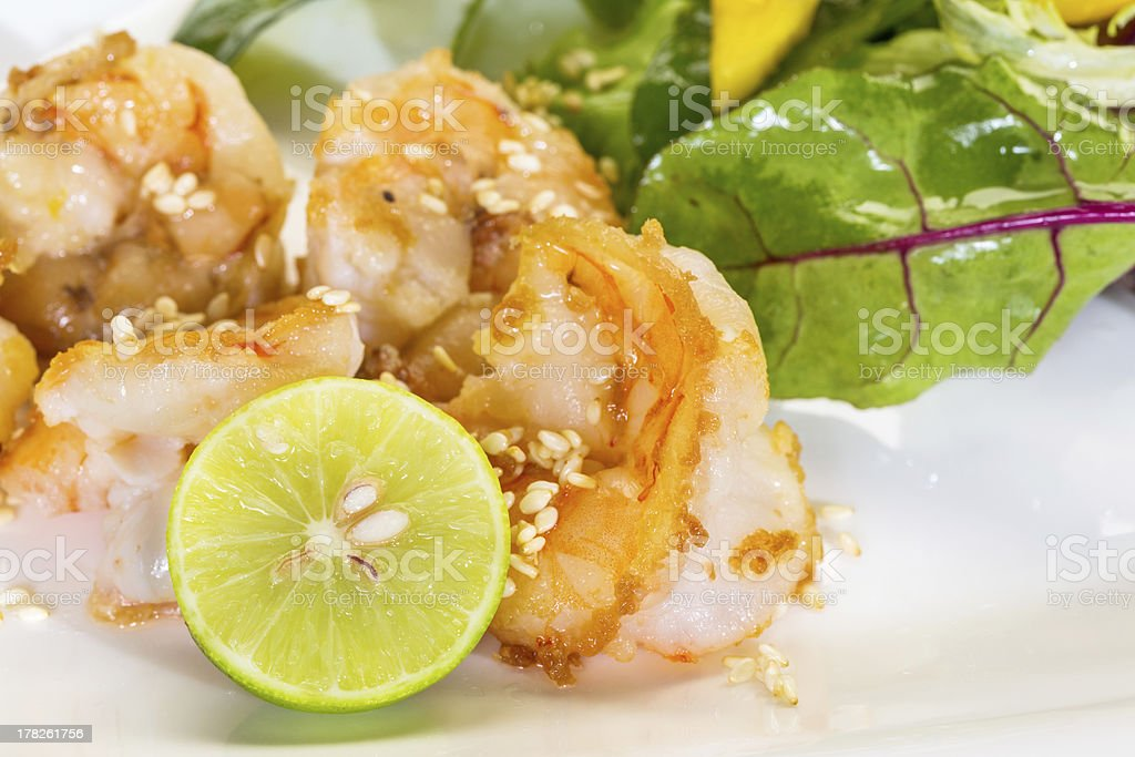 Fresh salad with fried shrimps, green leafs, mango royalty-free stock photo