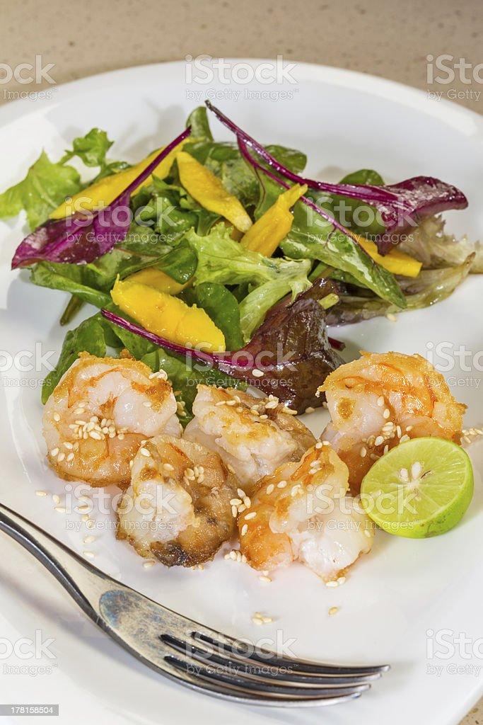 Fresh salad with fried shrimps, mango, lime royalty-free stock photo