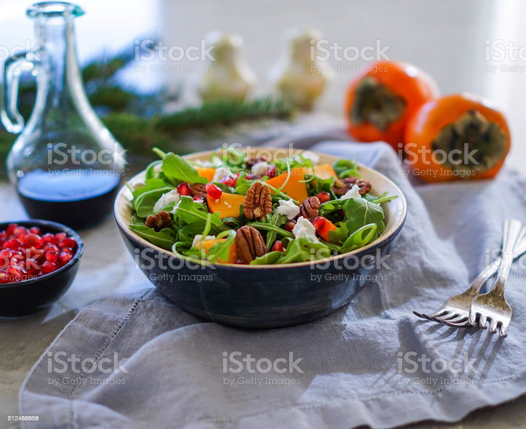 Fresh salad with fruits and greens. stock photo
