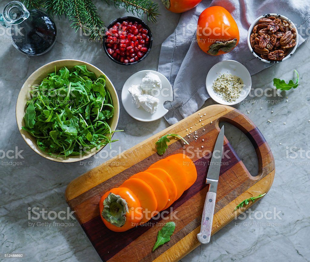 Fresh salad with fruits and nuts. stock photo