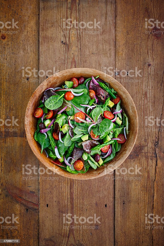 Fresh salad with organic ingrediants in a bowl stock photo