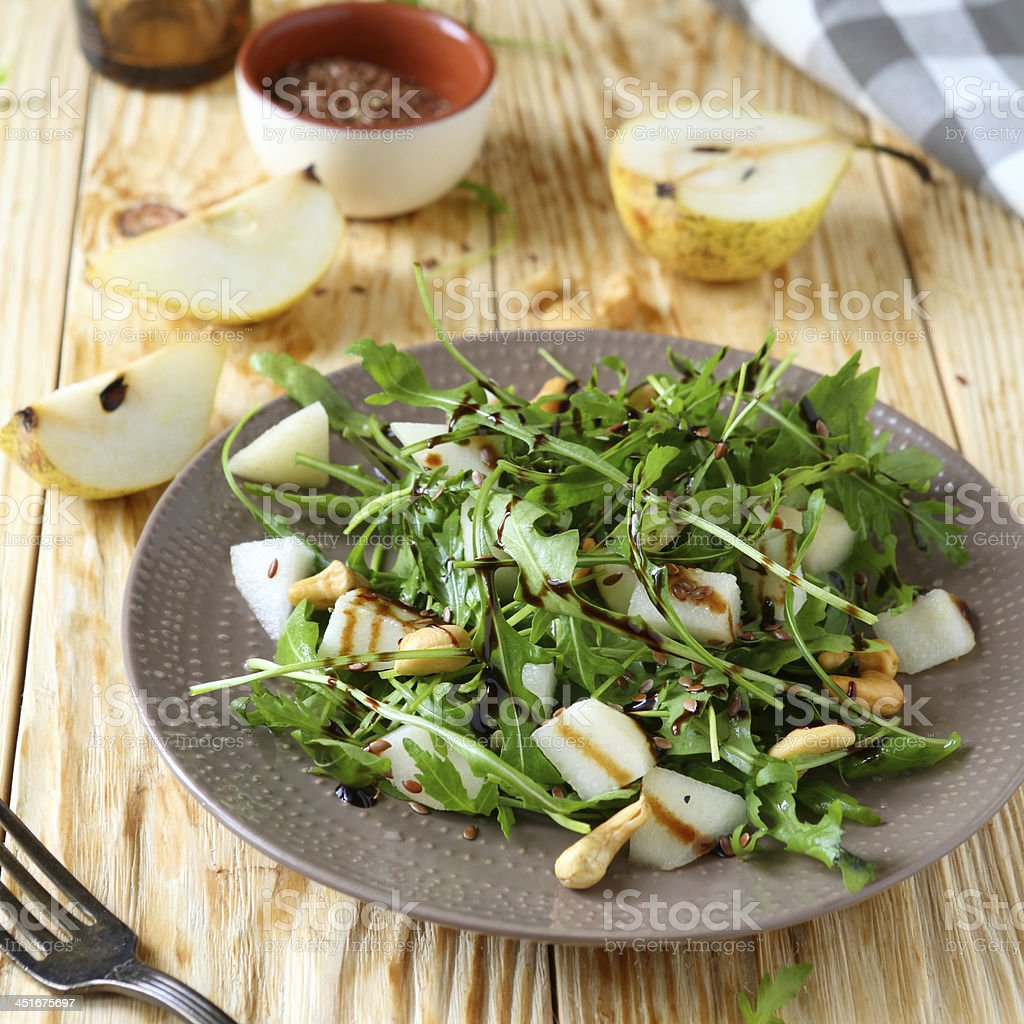 fresh salad with pear and arugula stock photo