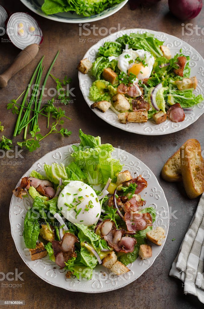 Fresh salad with poached egg stock photo