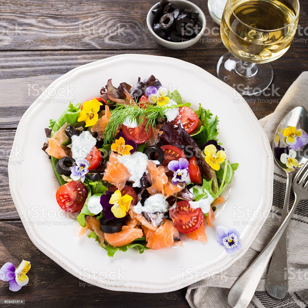Fresh salad with smoked salmon stock photo