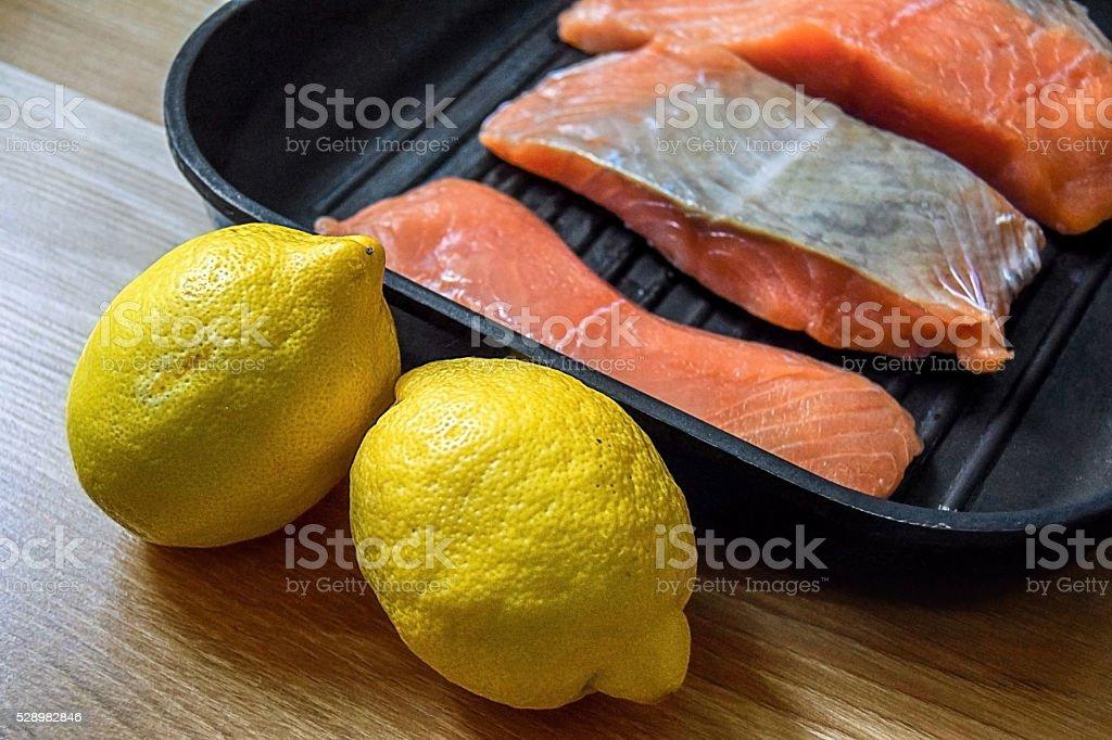 Fresh salmon fillet and lemon stock photo