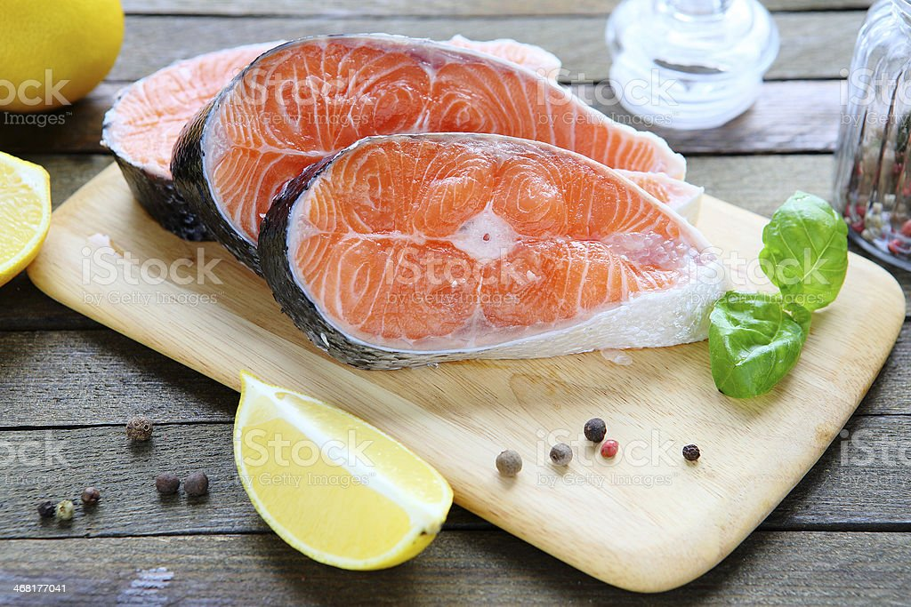 fresh salmon fillet on a board stock photo