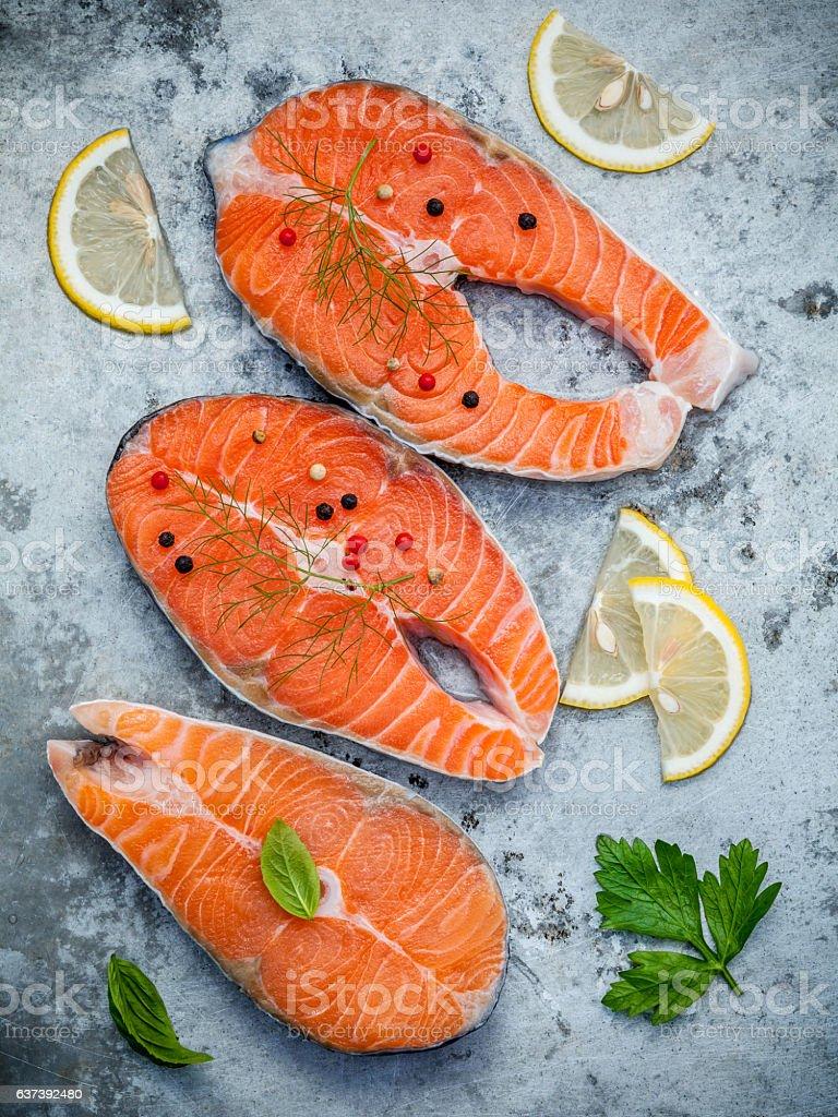 Fresh salmon fillet sliced flat lay on shabby metal background. stock photo