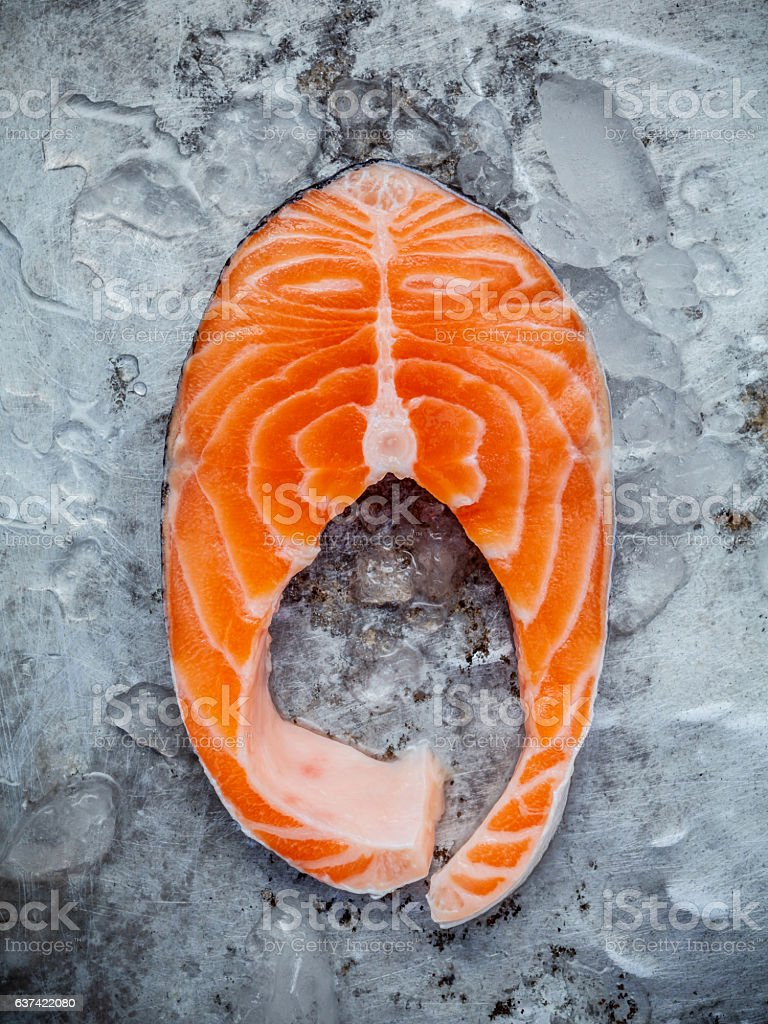 Fresh salmon fillet sliced flat lay on shabby metal background. stock photo