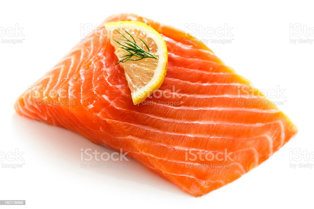 Fresh salmon fillet with a lemon and dill garnish stock photo