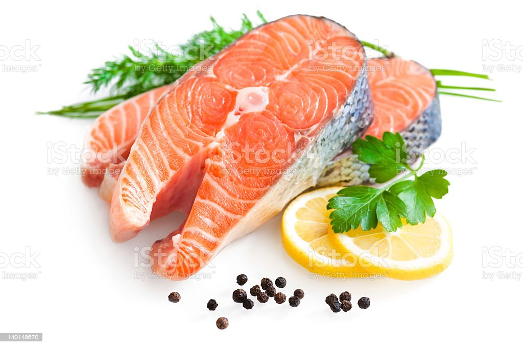 A Fresh salmon fillet with a side of lemon stock photo