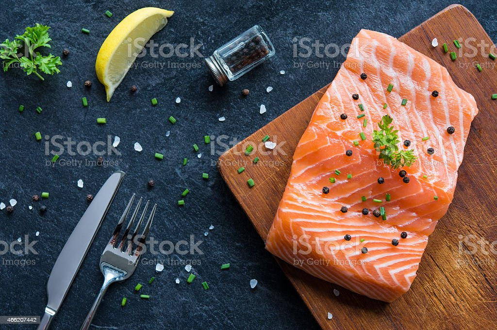 Fresh salmon fillet with pepper stock photo