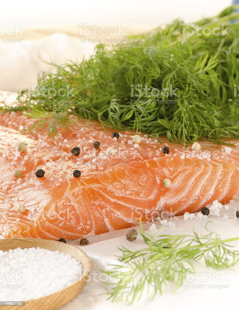Fresh salmon fillet with spices on baking paper royalty-free stock photo