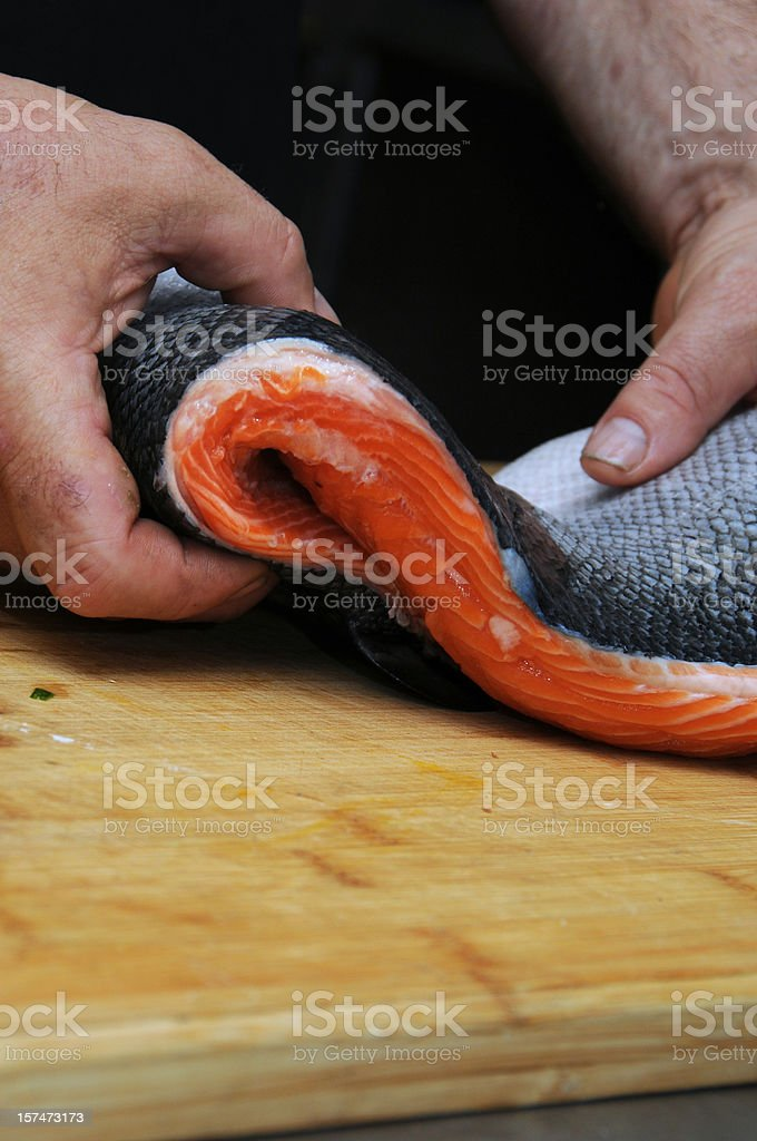 Fresh salmon fish on wooden cooking desk stock photo