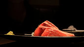 fresh salmon fish with black background