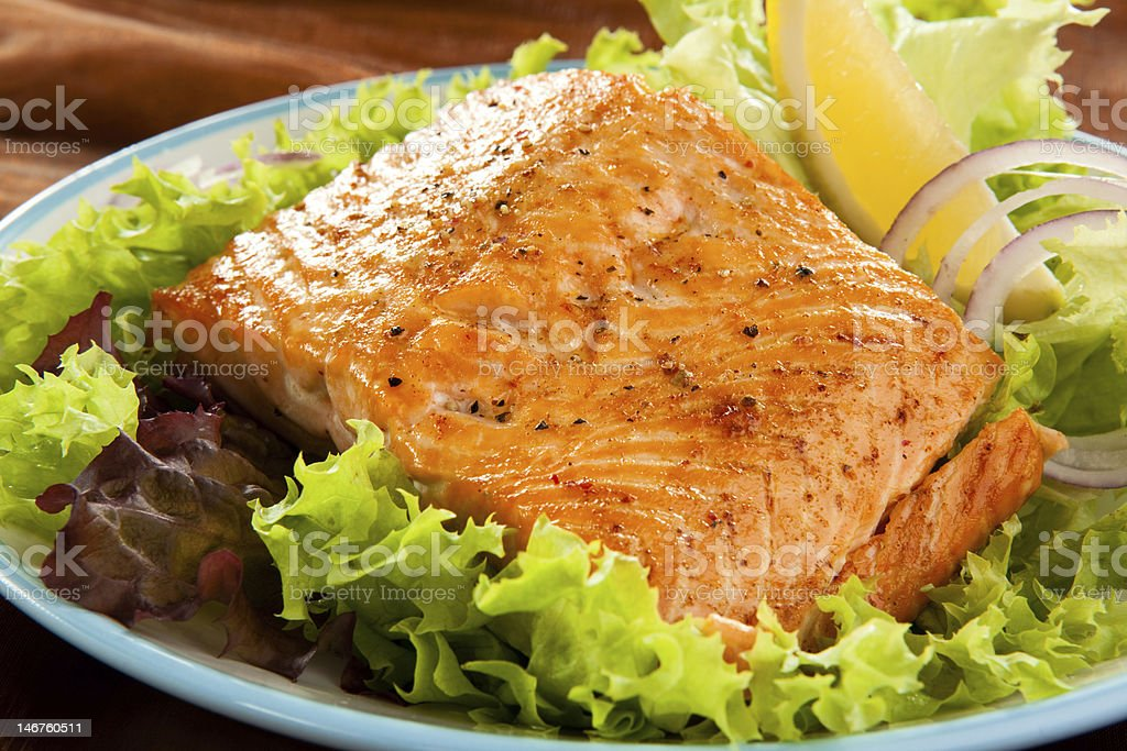 Fresh salmon on a pile of lettuce stock photo