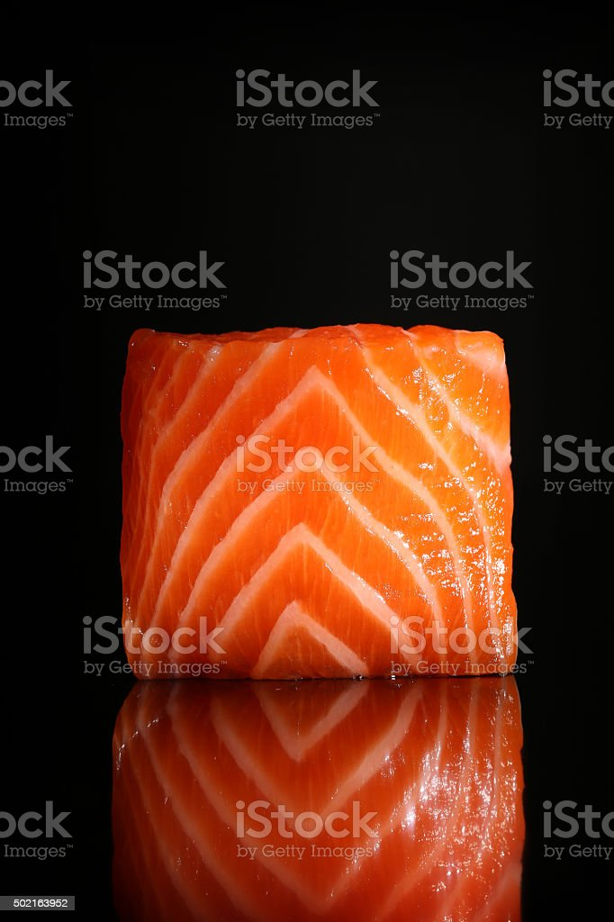 Fresh salmon piece isolated on black background with reflection stock photo