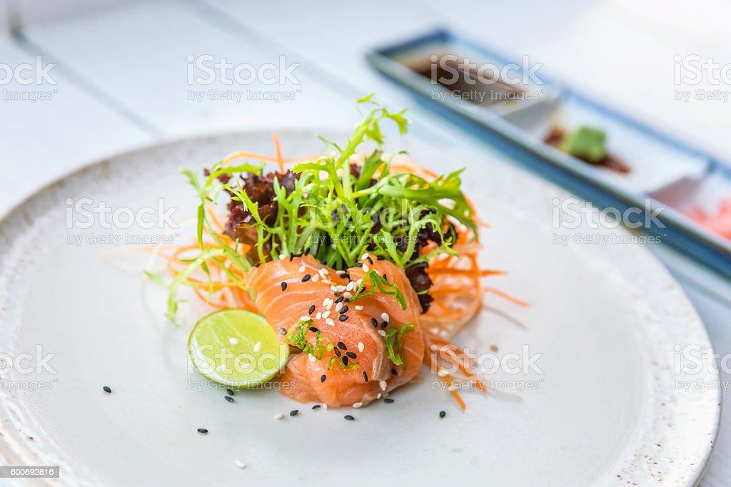 Fresh salmon sashimi with sauces stock photo