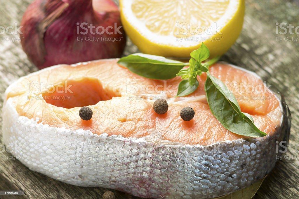 Fresh Salmon Steak on old Wood board royalty-free stock photo