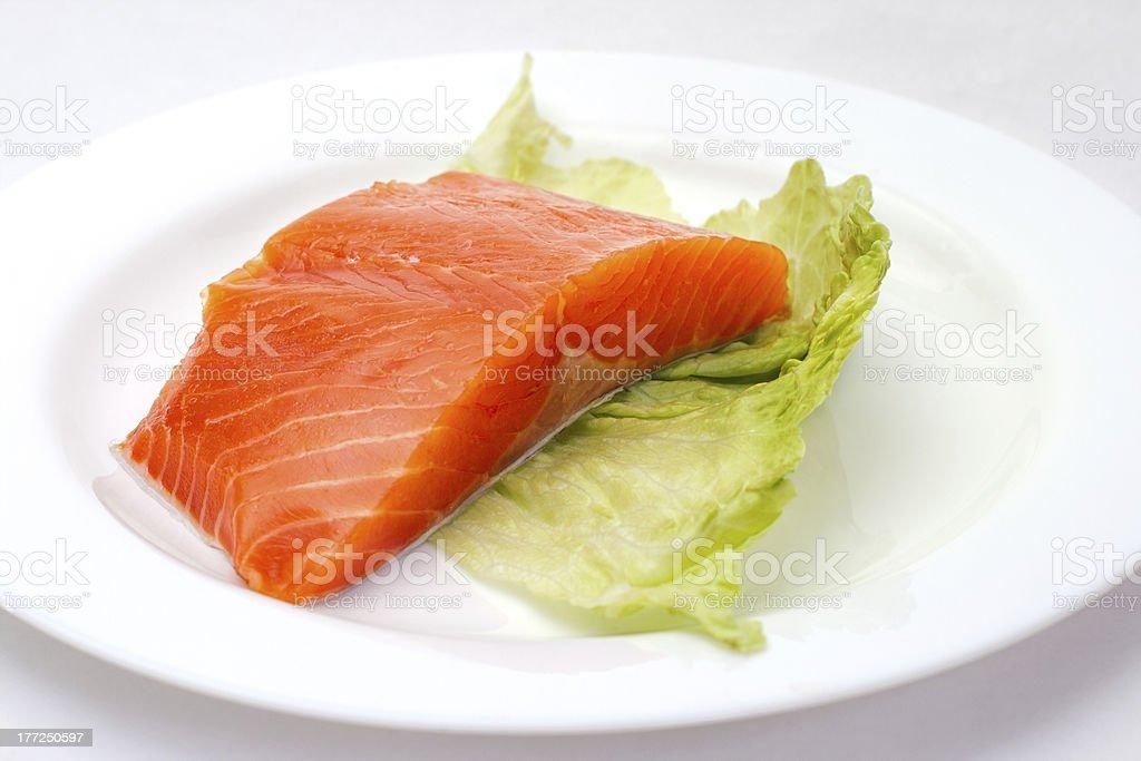 Fresh salmon steak on white plate royalty-free stock photo