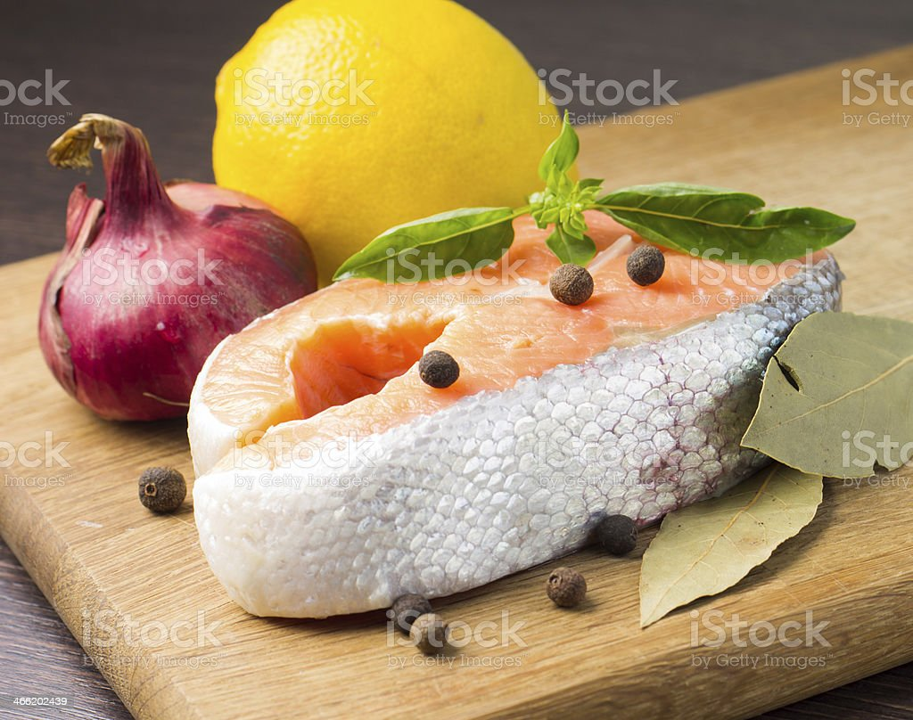 Fresh Salmon Steak on wood background royalty-free stock photo