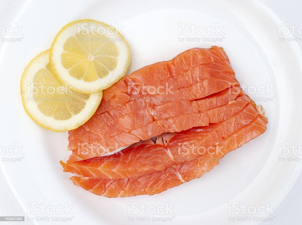 fresh salmon steak over white background royalty-free stock photo
