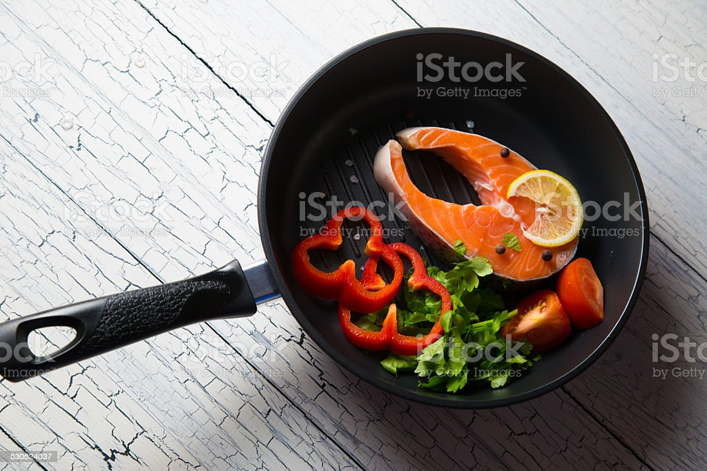 Fresh salmon steak with herbs and vegetables stock photo