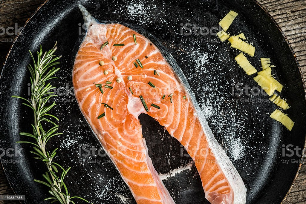 Fresh salmon with herbs and spices stock photo